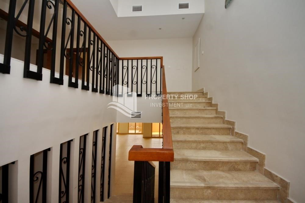 Stairs-Spacious Interiors, 4BR+M townhouse with large terrace area.