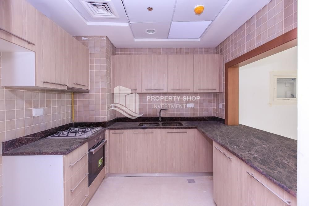 Kitchen-High ROI! 2 bedrooms with direct access to the pool and golf view