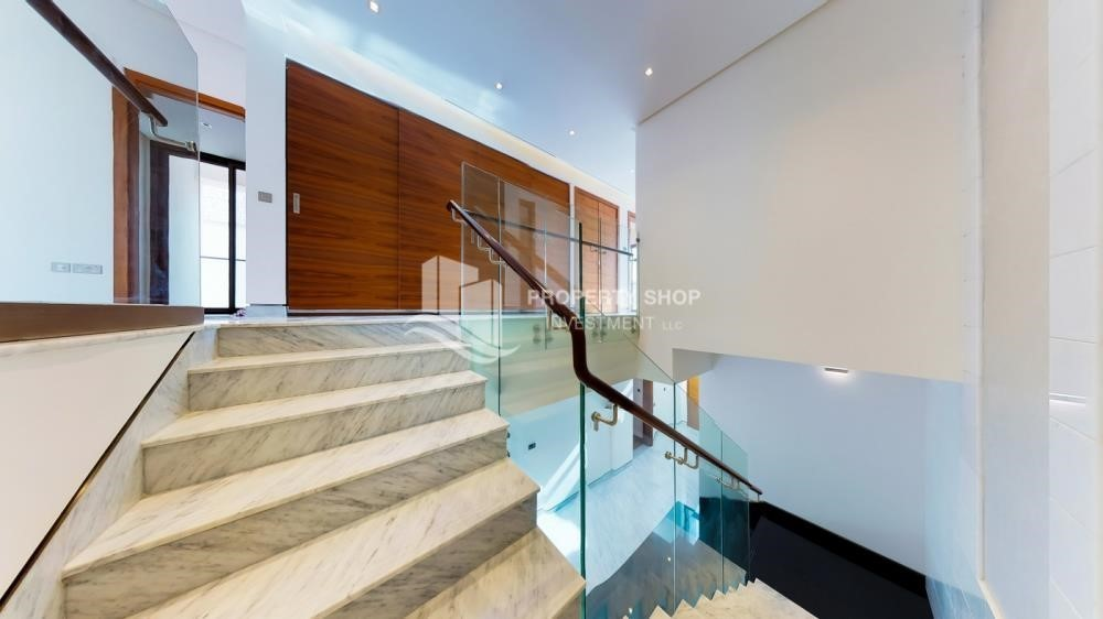Stairs-Available 5BR Villa in a luxurious community.
